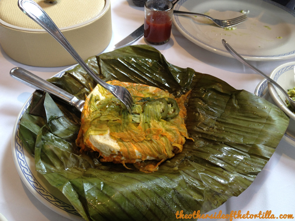 Queso fresco with flor de calabaza and jalapeño, wrapped in a banana leaf