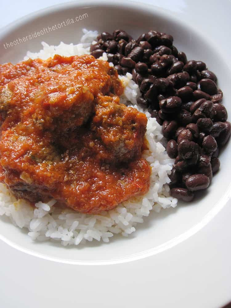 A classic recipe for albóndigas al chipotle, a Mexican meatball dish with a tomato-chipotle sauce. Recipe via theothersideofthetortilla.com.