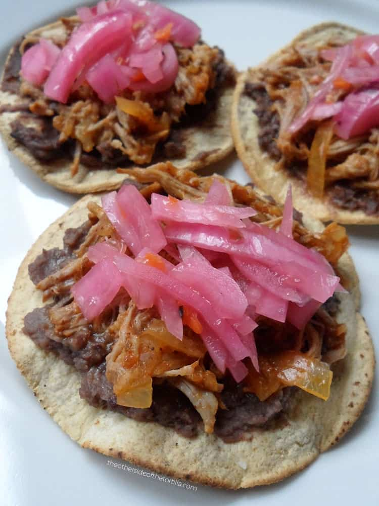How to make cochinita pibil in a slow-cooker or Crock-Pot via theothersideofthetortilla.com