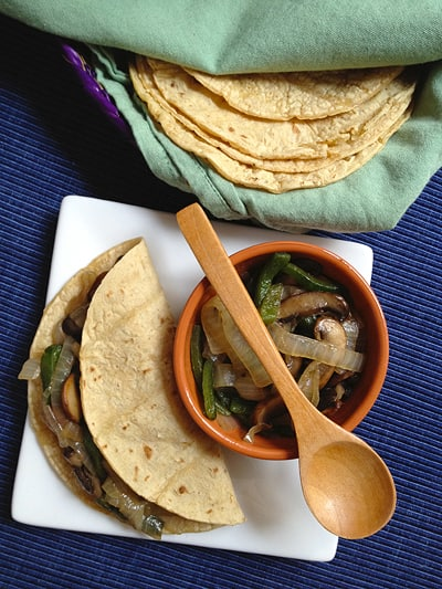 Vegetarian tacos made with sauteed mushrooms, poblano chile and onions. Recipe via theothersideofthetortilla.com