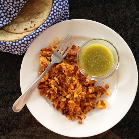 Huevo con chorizo breakfast tacos served with salsa verde from theothersideofthetortilla.com