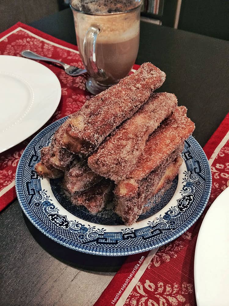 How to make churro French toast - Recipe via theothersideofthetortilla.com