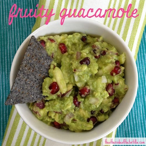 This fruity guacamole recipe with pineapple and pomegranate seeds is a sweet-and-savory spin on traditional guacamole and is gluten-free and vegan-friendly. | Get more Mexican recipes at theothersideofthetortilla.com