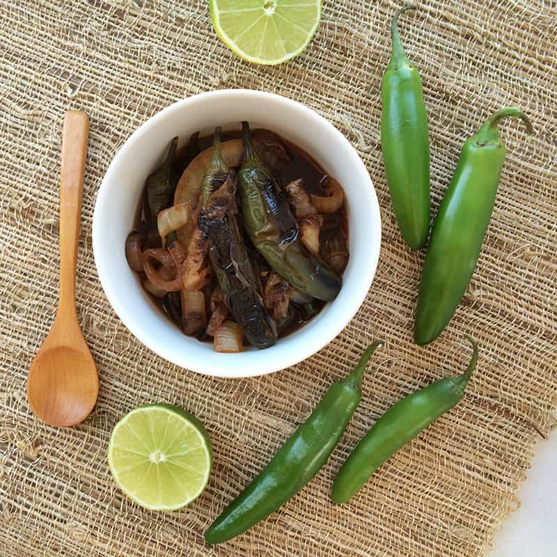 Chiles toreados recipe from theothersideofthetortilla.com made with serrano chiles, onion, lime juice and Kikkoman soy sauce