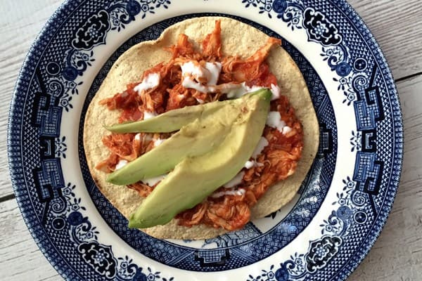 How to make tinga de pollo, a Mexican dish with a tomato base and shredded chicken. Great for tostadas, tacos, served with rice, or as a quesadilla! This dish is also sometimes known as tinga poblana or chicken tinga. Recipe via @MauraHernandez on The Other Side of The Tortilla.