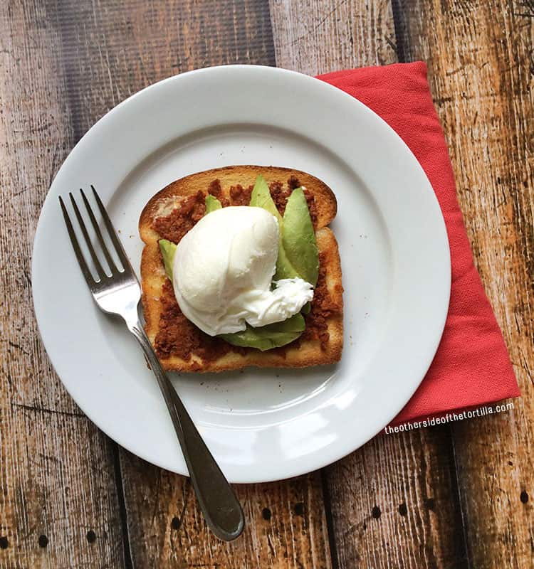Chorizo and Avocado Toast Topped with a Poached Egg