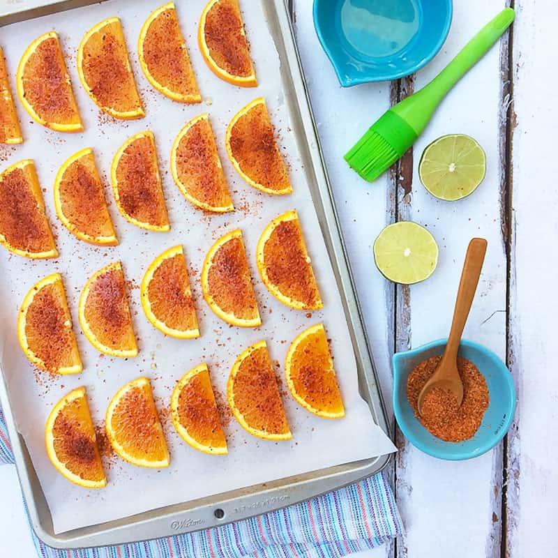 Healthy snack: Valencia oranges with lime juice and Tajín - A gluten-free, vegan-friendly recipe via theothersideofthetortilla.com