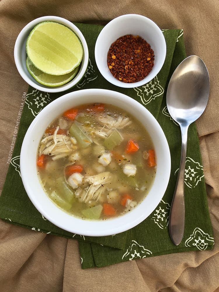 Make this hearty Mexican chicken soup with carrots, onion, Mexican oregano, chayote, hominy, barley and finish the flavor with lime juice and chile powder! Recipe via theothersideofthetortilla.com