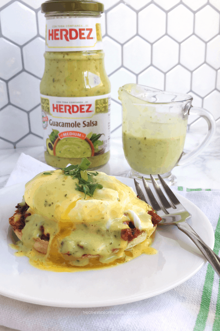 How to make Mexican eggs benedict with an ancho hollandaise, and topped with Herdez guacamole salsa. Recipe via theothersideofthetortilla.com