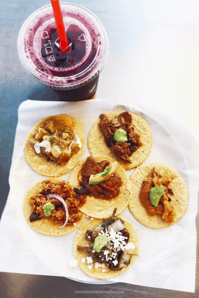 Taco Sampler and jamaica agua fresca at Guisados in Los Angeles, California