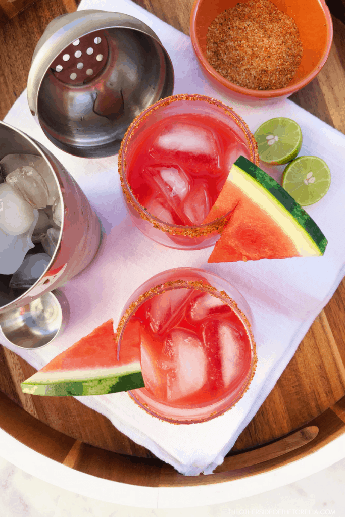 A quick and easy watermelon margarita that serves 2 but can easily be doubled or tripled to serve a crowd. Get this recipe on theothersideofthetortilla.com. #margaritas #mexicanfood #mexican