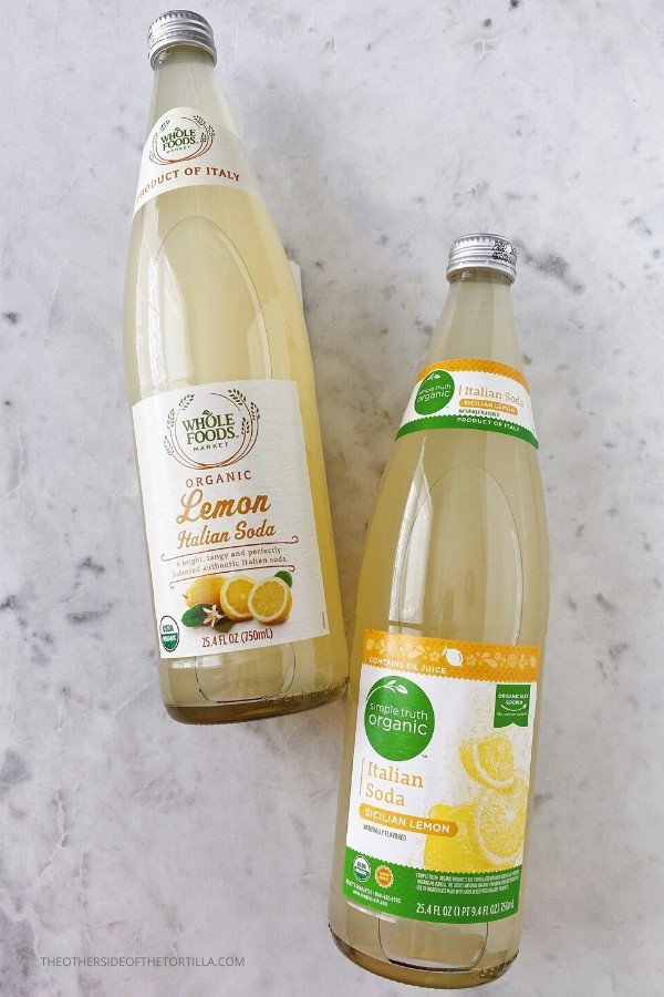 Bottles of Whole Foods organic lemon Italian soda and Simple Truth Organic Italian soda in Sicilian lemon flavor