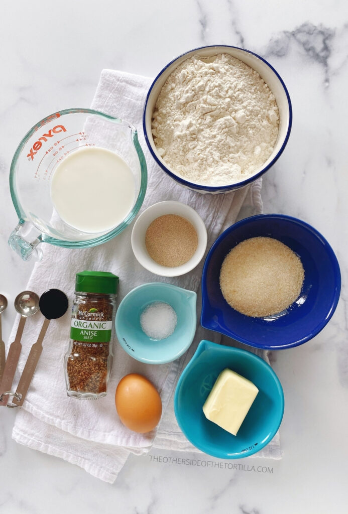 Ingredients, clockwise, from top left: milk, bread flour, instant yeast, sugar, kosher salt, butter, egg, anise seeds, vanilla bean paste